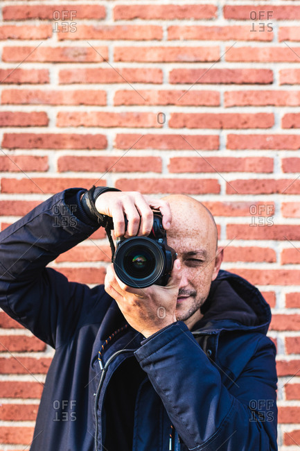Man Photographing Looking His Camera Posing Smiling