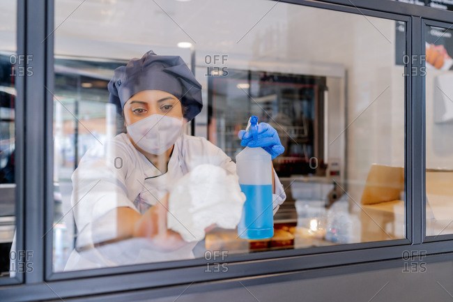 cook in her restaurant cleaning the showcases