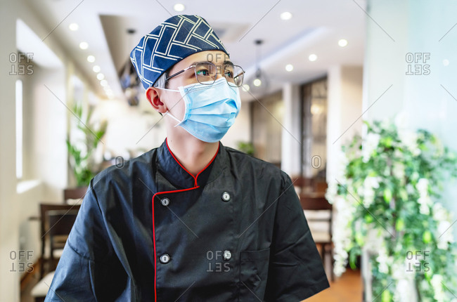 close-up of japanese chef expert in sushi