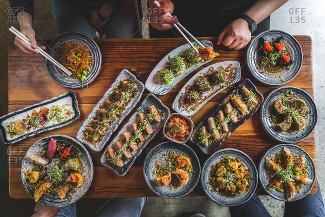 top town of people enjoying Asian food