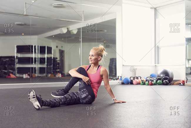 Fit woman warming up in fitness club