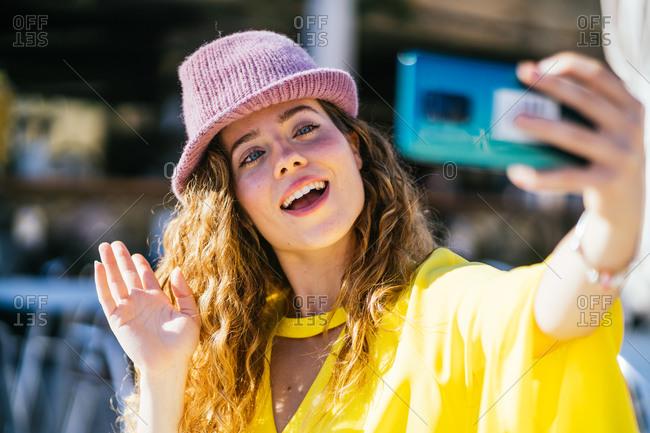 Woman having a video call on street