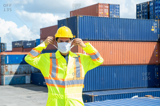 Container worker wearing protection face mask during coronavirus
