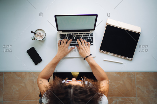 Aerial shot of unrecognizable woman working from home