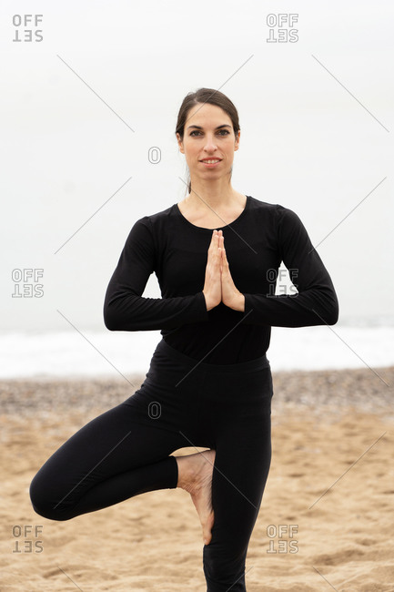 girl practicing The yoga posture of The Vrksasana