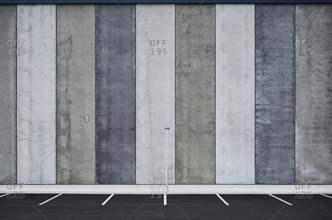Empty parking lots near wall with striped pattern