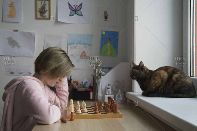 A girl plays a board game close-up. Chess.