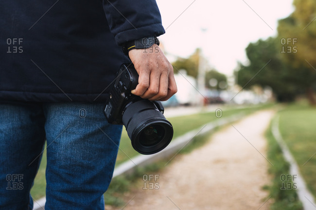 Close-up Of A Hand Holding A Photo Camera