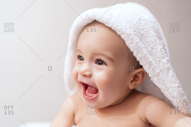 beautiful baby in his towel after a bath