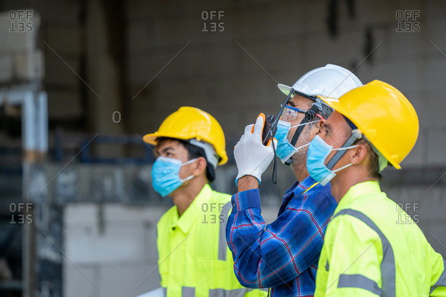 Engineer group wearing protective mask to Protect Against Covid-