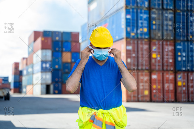Container worker wearing protective mask to Protect Against Covid