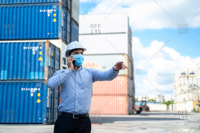 Business man wearing protective mask to Protect Against Covid-19