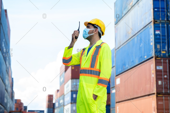 Foreman worker wearing protective mask to Protect Against Covid-