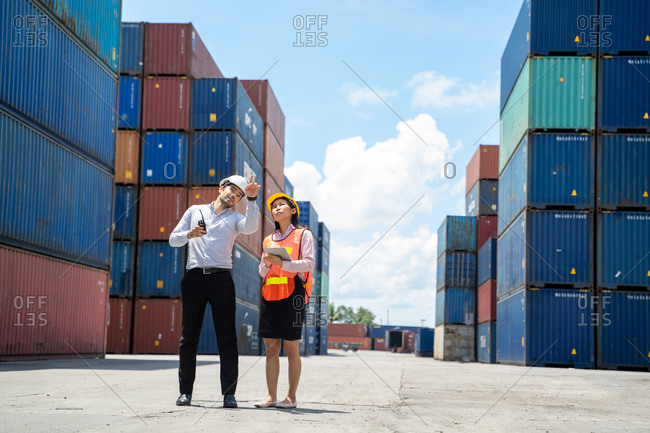 Businessman and secretary working inspecting online device in ya
