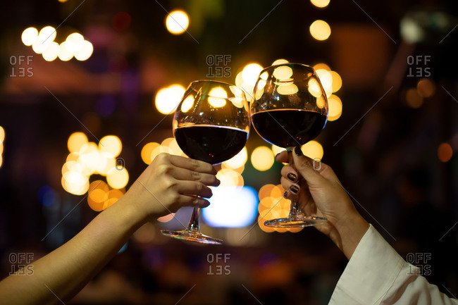 Women with friend celebrating Christmas party dinner with clinks