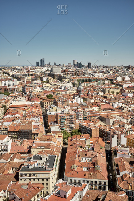 Amazing cityscape with red roofed buildings under blue sky