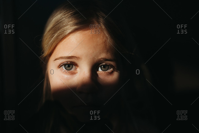 Little girl's eyes in bright light with black background