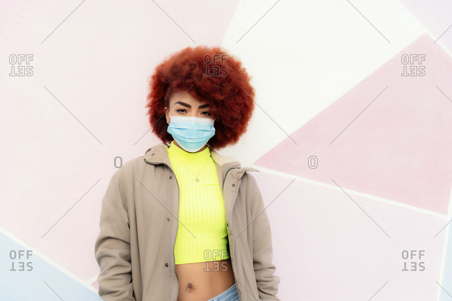 portrait of beautiful woman with afro hair wearing mask