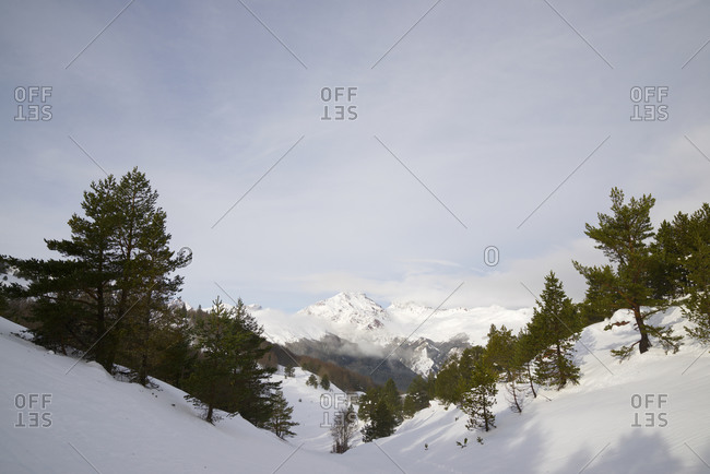 Snowy peaks in the Pyrenees, Aspe Valley in France.