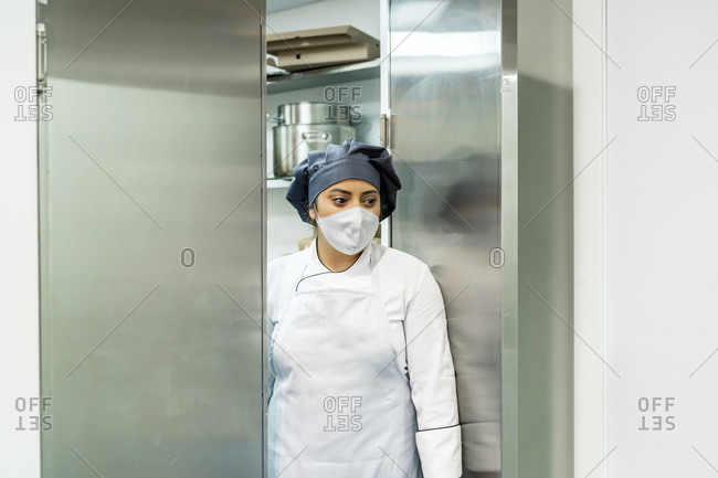cook in her restaurant coming out of the kitchen