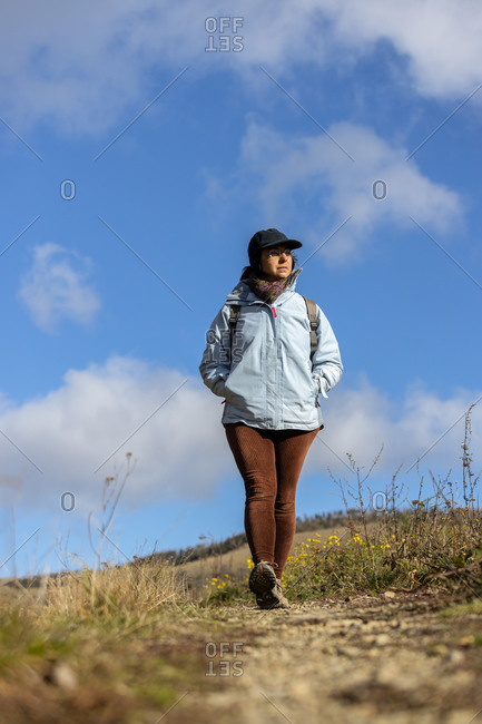 Middle aged spanish tourist woman walking on the Pyrenees mountain