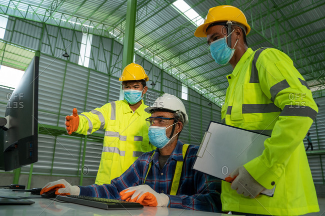 Group of engineer wearing protective mask to Protect Against Covid-19