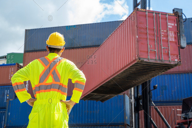 Asian foreman working and checking container box for logistic ex