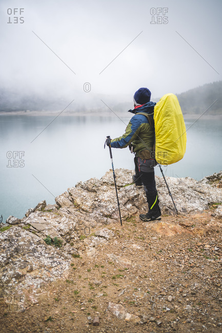 Hiker in front of reservoir in Cuber (Balearic Islands, Spain)