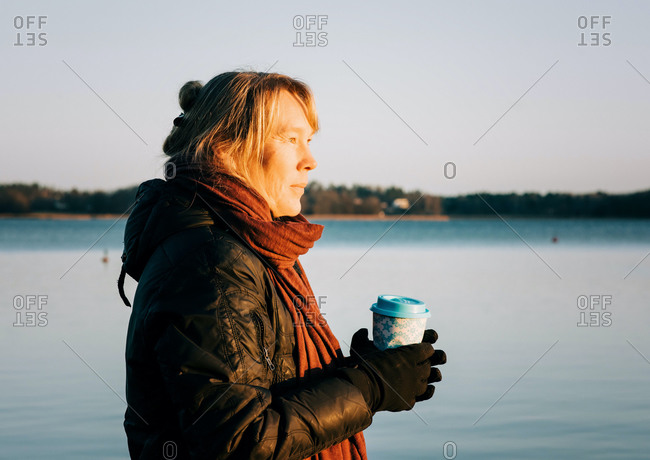 Swedish woman holding a hot drink after cold water swimming