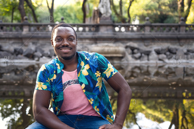 A young black man in park. Outdoor portrait of traveler.