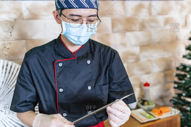 Japanese chef expert in sushi with his knife in hand