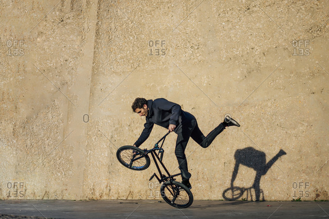 Man practicing tricks with the bmx bike in the city