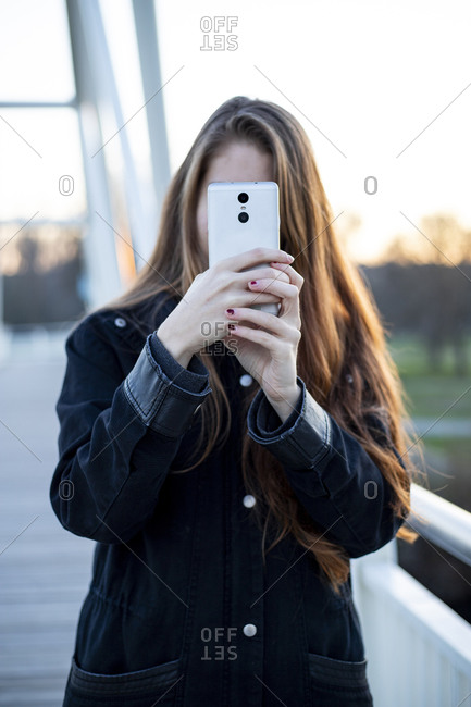 unknown no face woman taking a photo with her phone