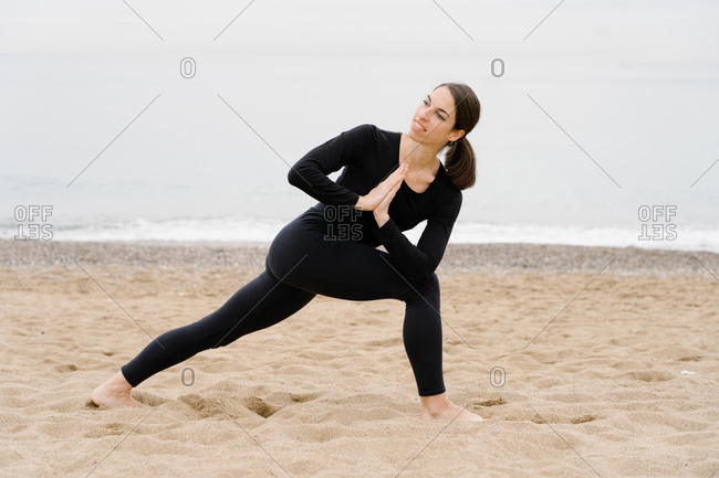 Young sporty fit woman trainer do practice individual hatha yoga instructor