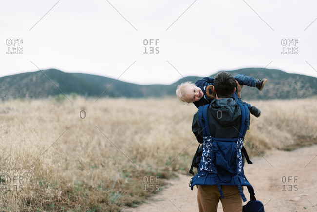 Young Father and baby hiking in Southern California in the mountains