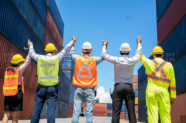 Engineer and worker team working at container yard port of import