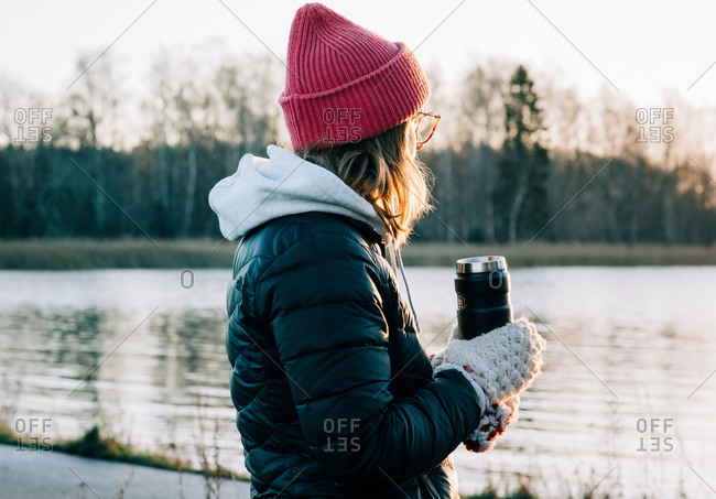 woman holding a hot drink after cold water swimming in Sweden