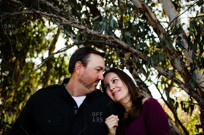 Husband & Wife Posing Under Tree at Park in Chula Vista