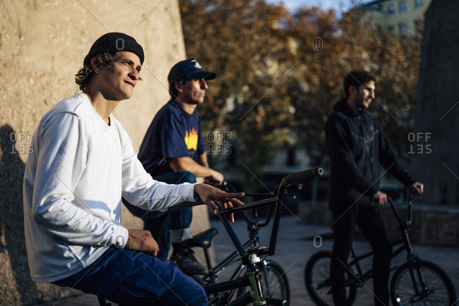 Three men posing with their bmx bikes in the city of Madrid Spain