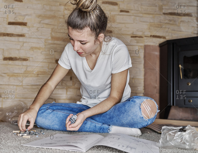 Close up of a caucasian girl picking a wooden pin or metallic sc