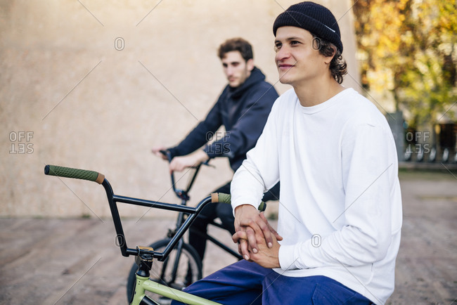 Two men posing with their bmx bikes in the city of Madrid Spain