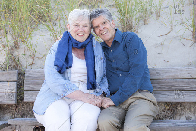 Married couple in their Seventies showing affection at Cold Storage Beach on Cape Cod