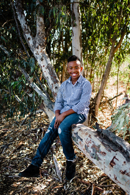 Young Boy Posing in Tree & Smiling for Camera at Park in Chula Vista