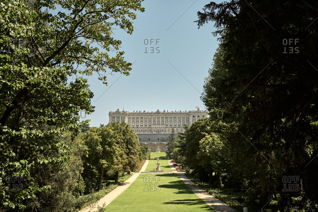 Madrid, Community of Madrid, Spain - August 26, 2020: Ancient palace and green garden in summer