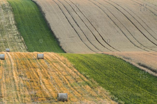 Idyllic view of straw bales on rolling fields near Kyjov, Hodonin District, South Moravian Region, Moravia, Czech Republic