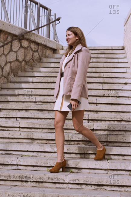 Attractive young woman walks through the city