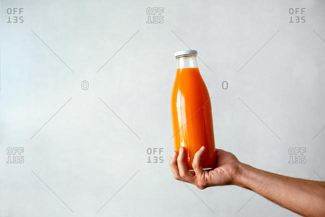 Freshly squeezed orange juice on white background
