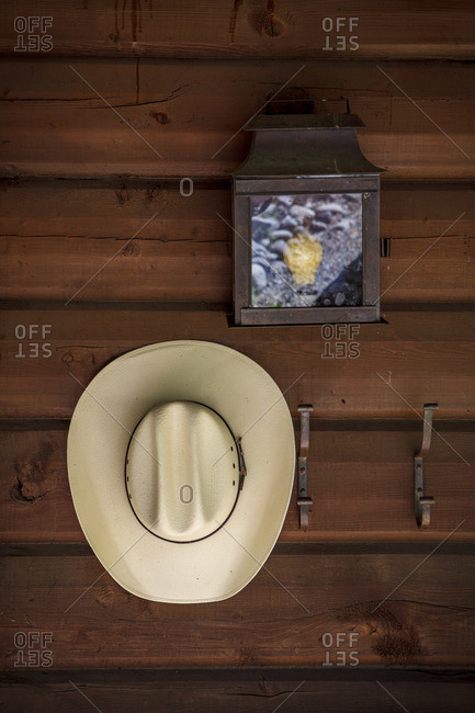 A cowboy hat rests on a coat rack outside a cabin in southern Colorado
