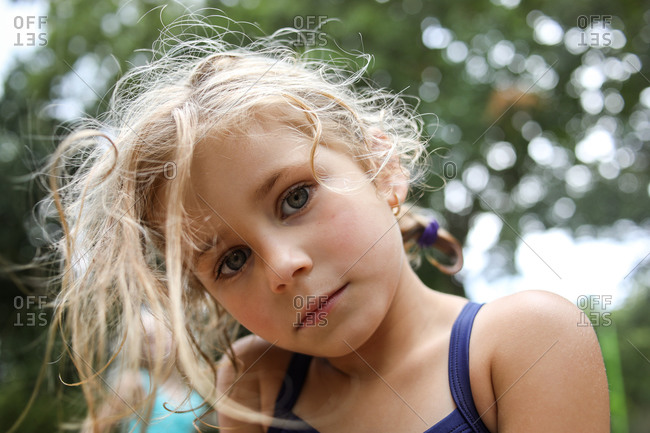 portrait of girl looking at camera with serious look on face close up