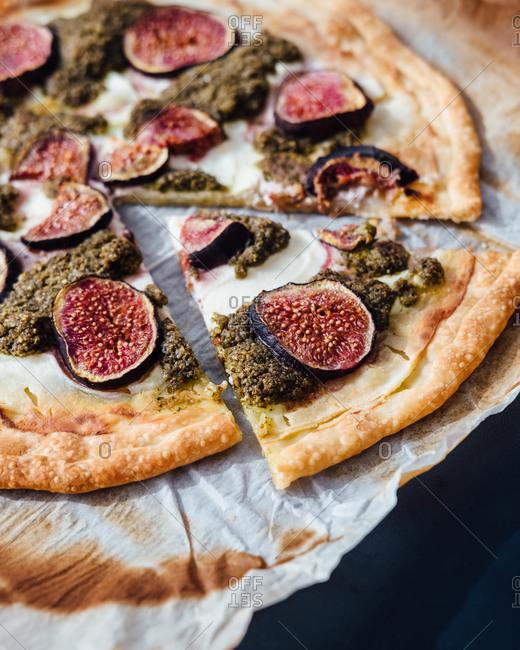 Freshly baked seasonal ricotta, fig and pesto pizza